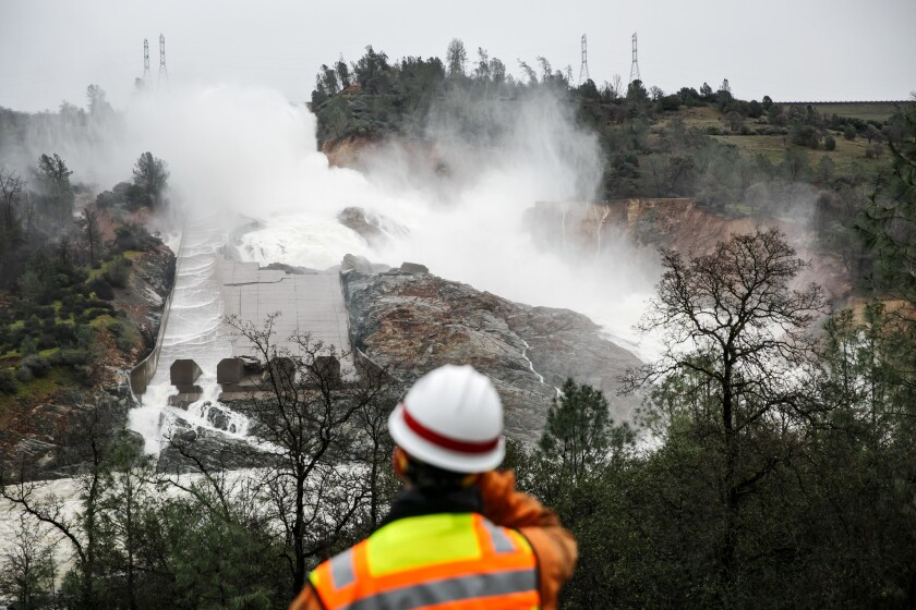 With a reduced flow on Sunday, most of the water being released from the Oroville Dam is not going down the spillway; it has broken through and is flowing down the hillside.