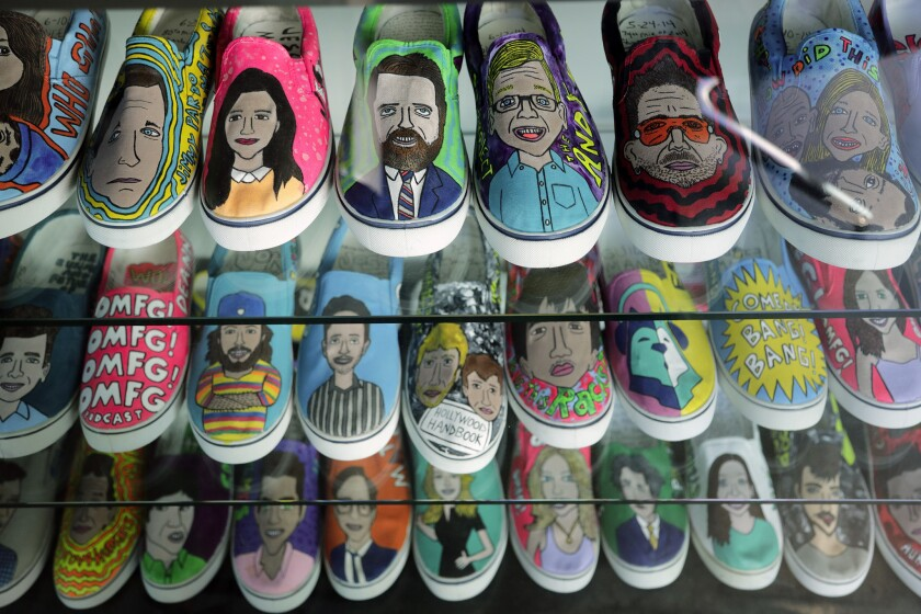 """LOS ANGELES, CA -- DECEMBER 11, 2018: A display of tennis shoes painted with portraits of """"Earwolf"""""""