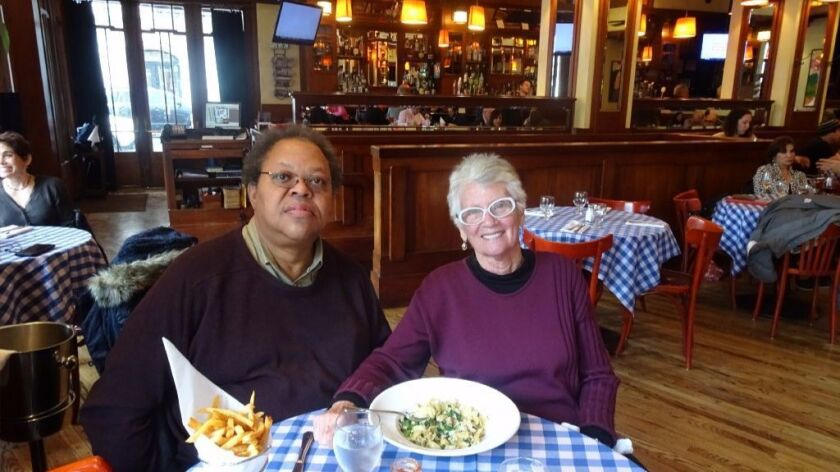 Columbia University professor George Lewis and San Diego concert promoter Bonnie Wright dine in New York. She credits him as a key musical mentor during his tenure at UCSD.