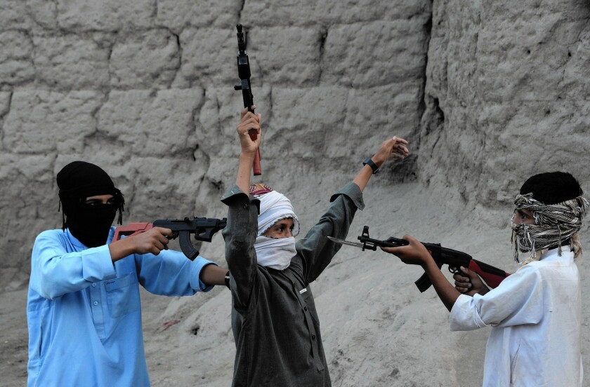 Children in Jalalabad, Afghanistan, play during the Eid al-Fitr celebrations on July 18, 2015.