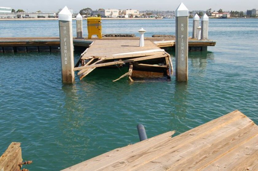 Part of the dock at Bali Hai Restaurant on Shelter Island was knocked out Saturday by tidal surges caused by the massive earthquake in Chile.
