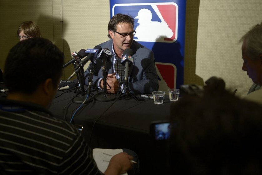 Dodgers Manager Don Mattingly answers questions during winter meetings in Lake Buena Vista, Fla. on Tuesday.