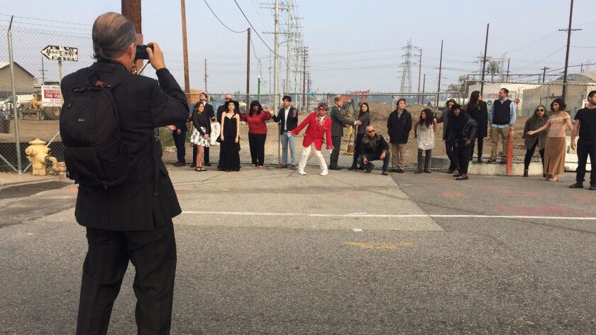 Harry Gamboa Jr. photographs Virtual Verité performers at the foot of the 6th Street Bridge.