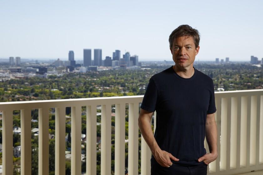 Nicholas Berggruen, 54, in his condominium high above Sunset Boulevard in W