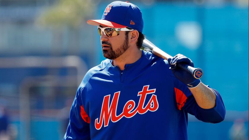 New York Mets' Adrian Gonzalez takes batting practice during spring training baseball practice Frida