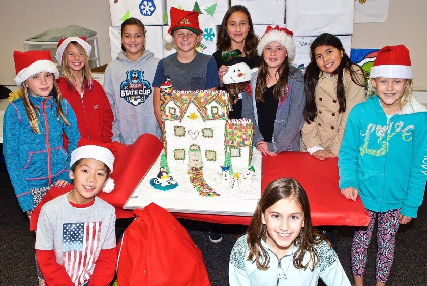 Calavera Hills Elementary took home top honors and a $350 prize in Cape Rey Carlsbad's second holiday Gingerbread House Contest. Clockwise from bottom left, gingerbread team members Jason Cheung, Devon Jones, Avalon Besso, Gia Kiesling, Anderson Filippi, Sophia McKenna, McKena Torpey, Giselle Resendiz, Keala Geary, Ana Ambrose. Hope Elementary earned second place and a $150 prize.