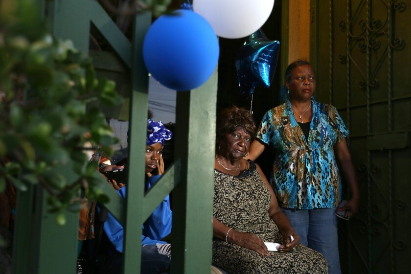 """""""It's a shame that his life ended at 18 years old,"""" said Carlena Hall, center, a great-aunt of Carnell Snell Jr., who was fatally shot by LAPD police in South L.A. At left is Tranell Snell, 17, Snell's sister, and at right is Debbie Washington, his aunt."""