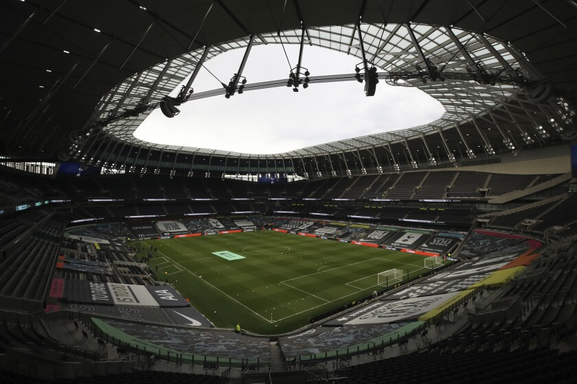 FILE - This Sunday, May 2, 2021 file photo shows a general view of the Tottenham Hotspur Stadium in London. Tottenham has paid back the 175 million pounds ($243 million) it borrowed from the Bank of England as part of a coronavirus loan scheme, freeing up cash that could help the Premier League club sign players and a new manager. The north London club said Friday, June 18, 2021 that it repaid the low-interest loan from the 250 million pounds ($347 million) it recently raised from institutional investors.(Nick Potts/Pool via AP, file)