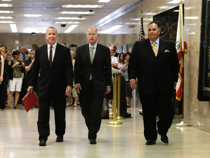 State Senate leader Darrell Steinberg (D-Sacramento), left, Gov. Jerry Brown and Assembly Speaker John Pérez (D-Los Angeles) walk to a news conference in the Capitol to discuss the budget compromise they reached.