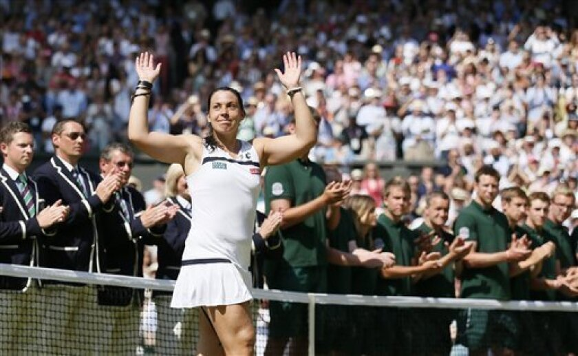 Marion Bartoli of France gestures to the crowd after defeating Sabine Lisicki of Germany in the Women's singles final match at the All England Lawn Tennis Championships in Wimbledon, London, Saturday, July 6, 2013. (AP Photo/Stefan Wermuth, Pool)