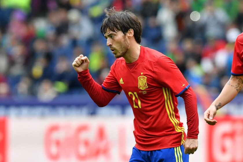 Spain's  David Silva celebrates after scoring during a friendly soccer match between Spain and South Korea in Salzburg, Austria, Wednesday, June 1, 2016. The Spain National Football Team is in Austria for a training camp in preparation for the  EURO 2016 soccer championships, hosted by France.(AP P
