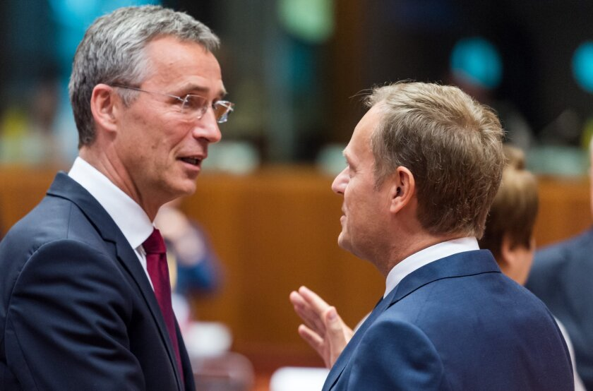 European Council President Donald Tusk, right, speaks with NATO Secretary-General Jens Stoltenberg during a meeting between the Western military alliance and officials of the European Union, which is also enduring strained relations with Russia.