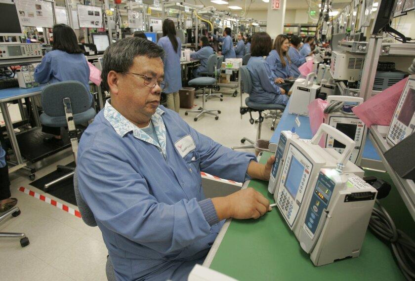 Manuel DeGuzman tested an Alaris intravenous pump at CareFusion's manufacturing facility in Mira Mesa.