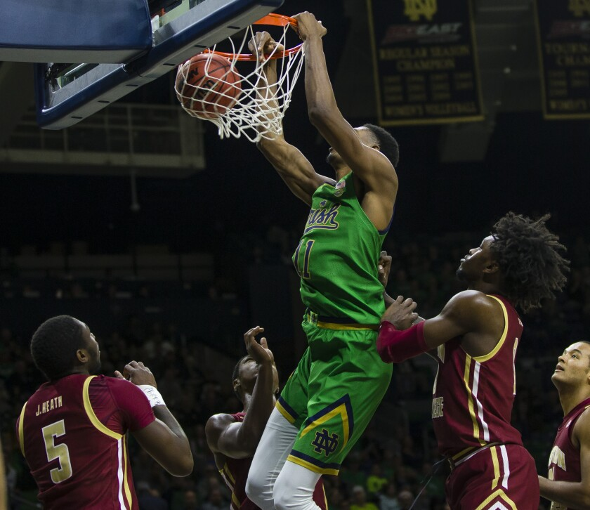 Notre Dame's Juwan Durham (11) dunks against Boston College during an NCAA college basketball game Saturday, Dec. 7, 2019 at Purcell Pavilion in South Bend, Ind. (Michael Caterina/South Bend Tribune via AP)