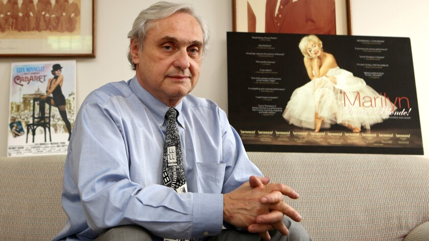 Judge Alex Kozinski, pictured in 2015 in his chambers, said he'll retire amid more than a dozen reports of sexual misconduct or inappropriate comments.