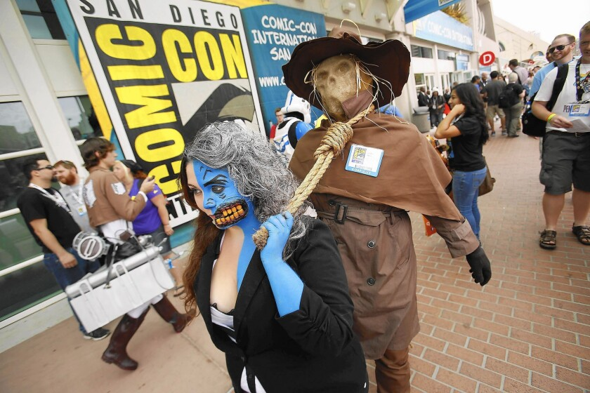 """Comic-Con is a summer party where San Diego's downtown is invaded by pop culture fans in zany costumes. Above, Angie Rodriguez, left, and Jonathon Antone are dressed as """"Batman"""" characters during the 2013 convention."""