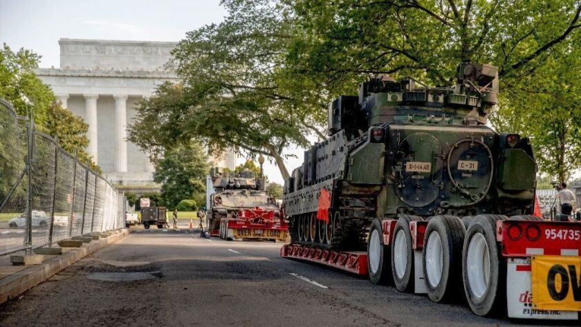 """Military vehicles are parked near the Lincoln Memorial for President Trump's """"Salute to America"""" event July 4. Critics say Trump is politicizing the Independence Day festivities."""