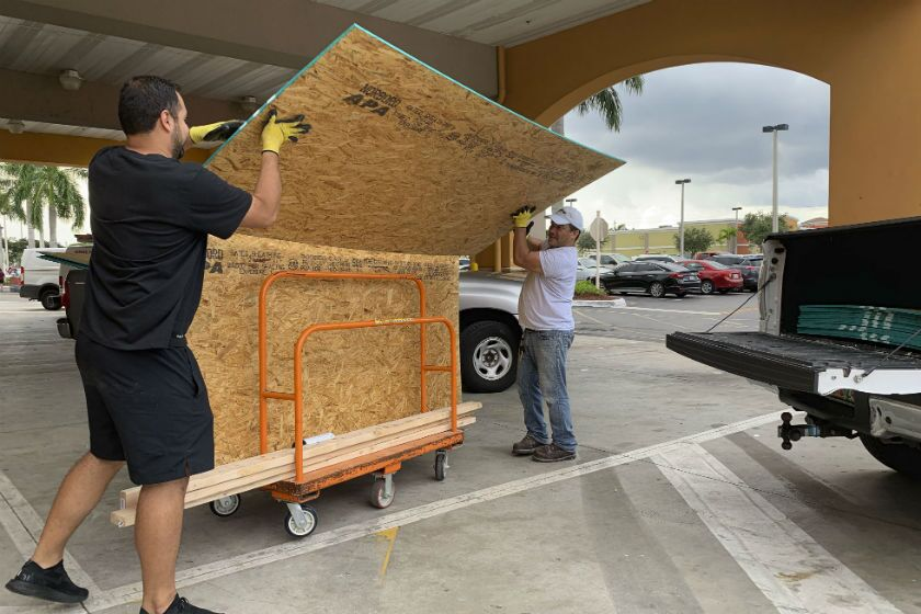 Shoppers load their truck with supplies to board up windows Aug. 29 as they prepare for Hurricane Dorian in Pembroke Pines, Fla.