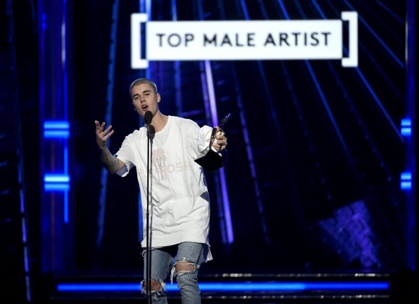 Justin Bieber accepts the award for top male artist at the Billboard Music Awards at the T-Mobile Arena on Sunday, May 22, 2016, in Las Vegas. (Photo by Chris Pizzello/Invision/AP)