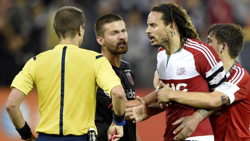Revolution midfielder Jermaine Jones is restrained by teammate Kelyn Rowe and D.C. United midfielder Perry Kitchen after he was given a red card and ejected during the second half on Oct. 28, 2015.