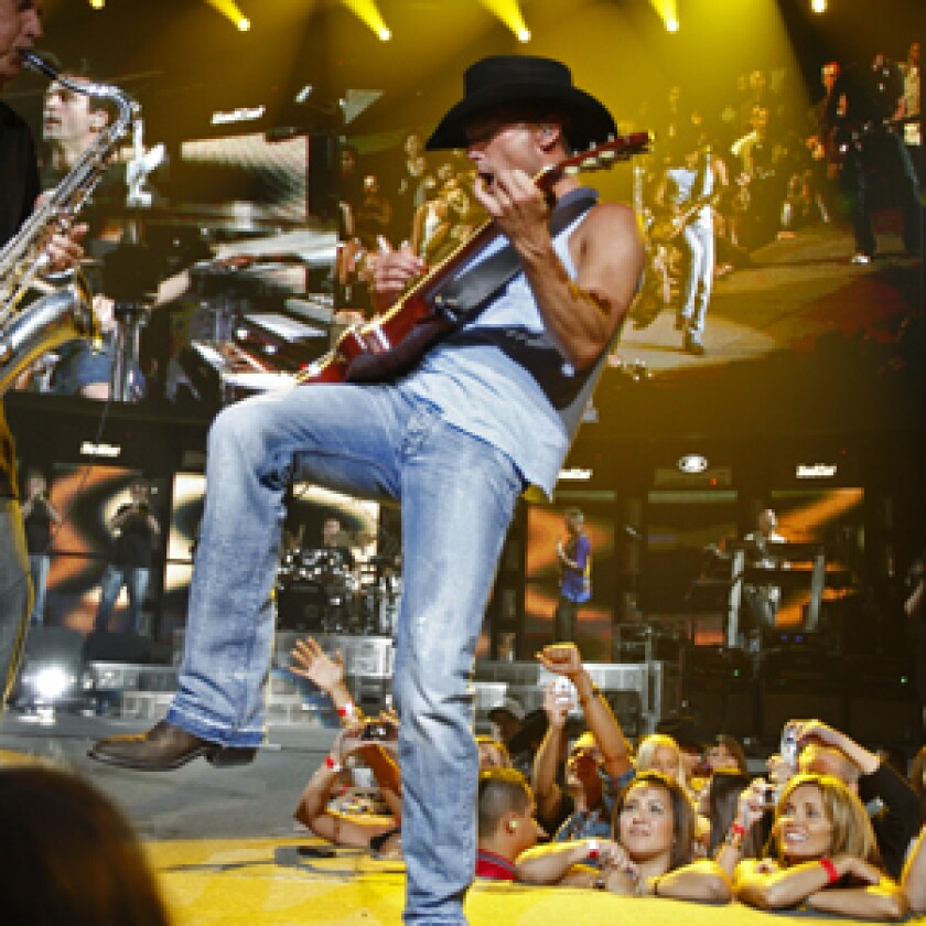 SPIRIT IS WILLING: Chesney lasted about 90 minutes before pals such as Kid Rock and Uncle Kracker helped out.