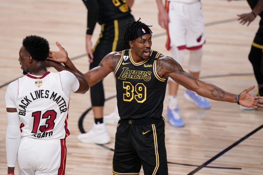 Lakers center Dwight Howard, right, reacts next to Miami Heat forward Bam Adebayo.