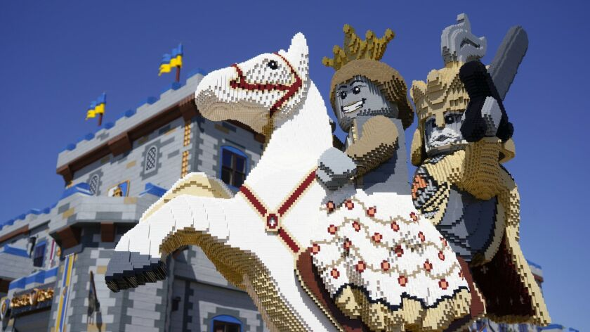A statue made from Legos is at the front entrance to Legoland's newest addition, the Castle Hotel.
