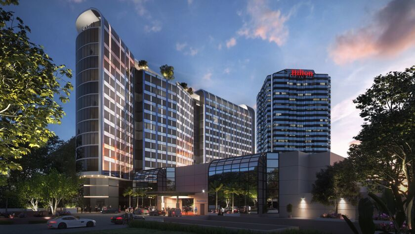 The owner of the Hilton Los Angeles/Universal City hotel is seeking to build a $100-million expansion. The rendering shows the existing 24-story tower, right, and the proposed 15-story addition with 365 rooms.