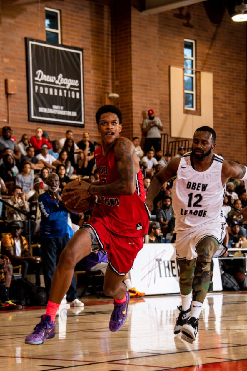 UCLA forward Shareef O'Neal drives to the basket in his Drew League debut.