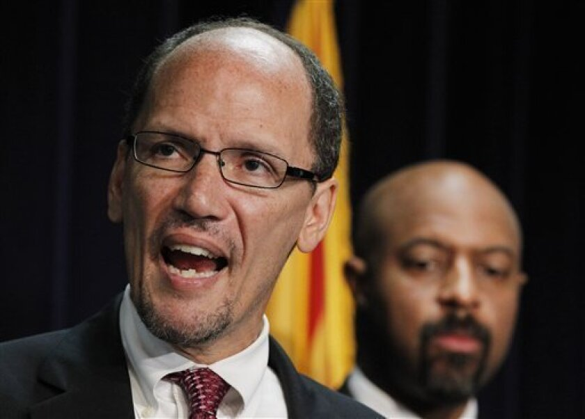 FILE - In this Thursday, May 10, 2012 file photo, United States Assistant Attorney General Thomas Perez, left, who heads up the civil rights division at the Department of Justice, is joined by Deputy Assistant Attorney General for Civil Rights, Roy Austin, as Perez announces a federal civil lawsuit