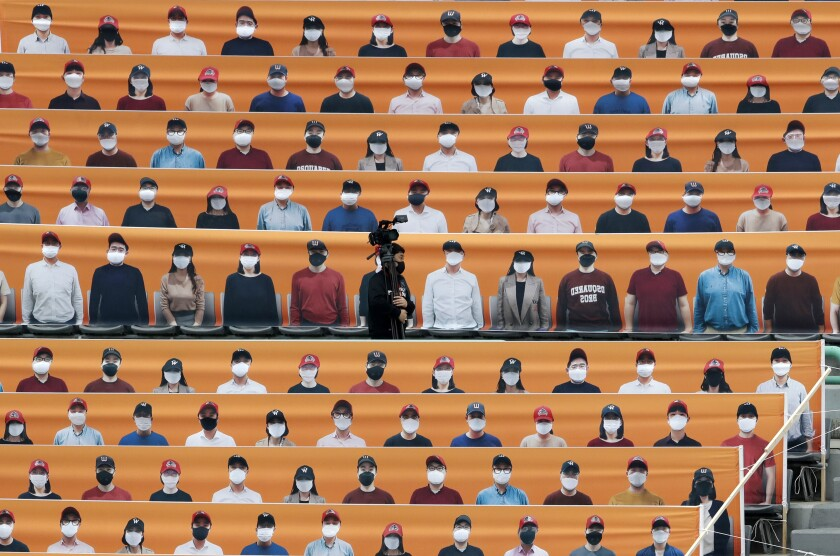 Stadium seats in Incheon, South Korea, are covered with pictures of fans before the start of a baseball game May 5.