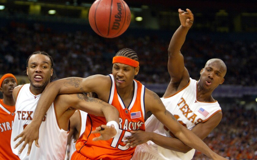 Carmelo Anthony, center, playing for Syracuse, with Texas' James Thomas and Sydmill Harris in 2003.