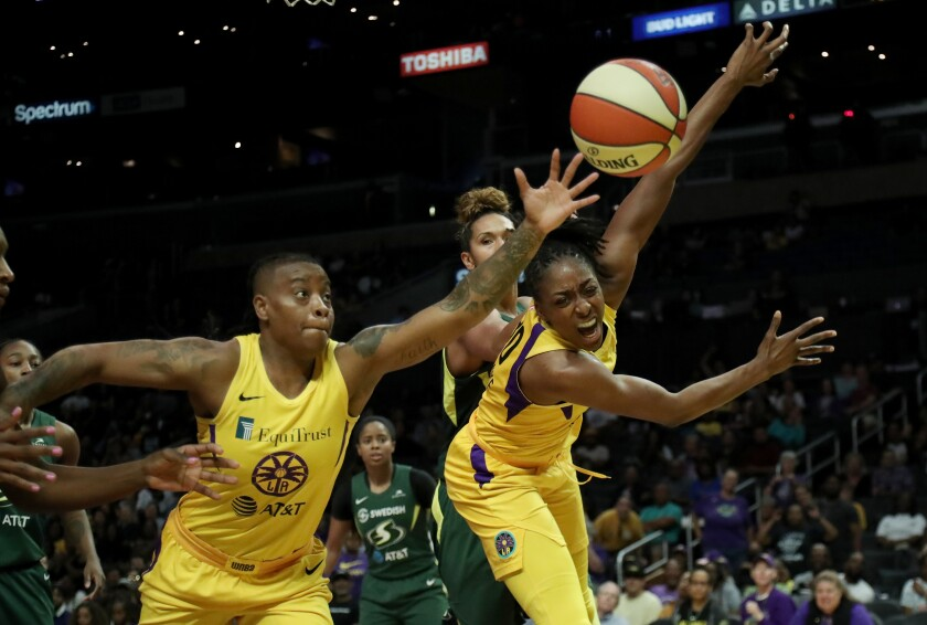 Sparks teammates Riquna Williams and Nneka Ogwumike chase after a rebound.