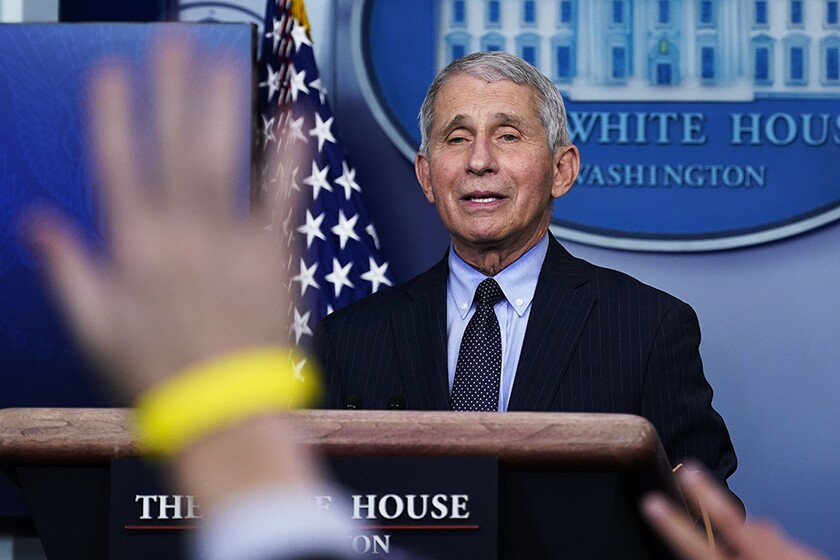 Dr. Anthony Fauci fields reporters' questions at the White House on Thursday.
