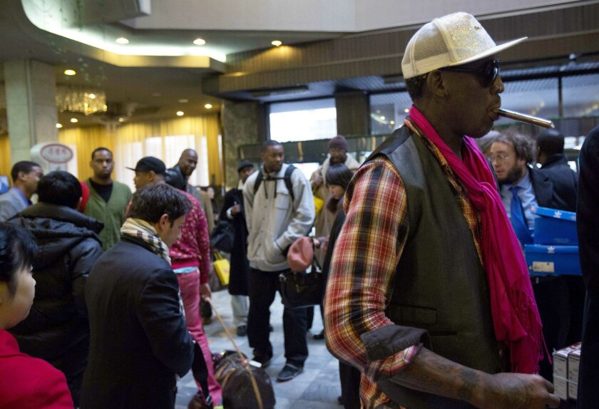 """Former NBA basketball star Dennis Rodman, right, and fellow U.S. basketball players arrive at a hotel in Pyongyang, North Korea Monday, Jan. 6, 2014. Rodman arrived in the North Korean capital with a squad of former basketball stars in what he calls """"basketball diplomacy,"""" although U.S. officials have criticized his efforts. (AP Photo/David Guttenfelder)"""