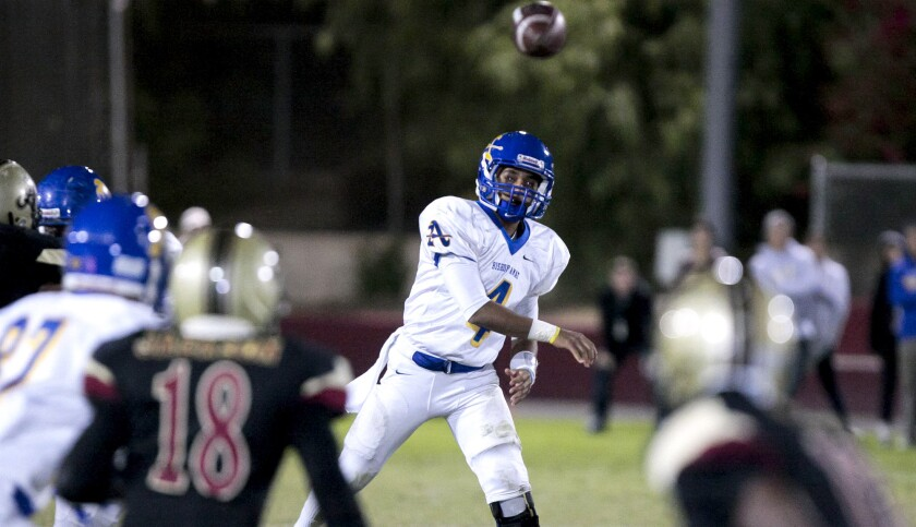 Bishop Amat quarterback Koa Haynes attempts a pass during the first half of a game against Bishop Alemany on Friday night.