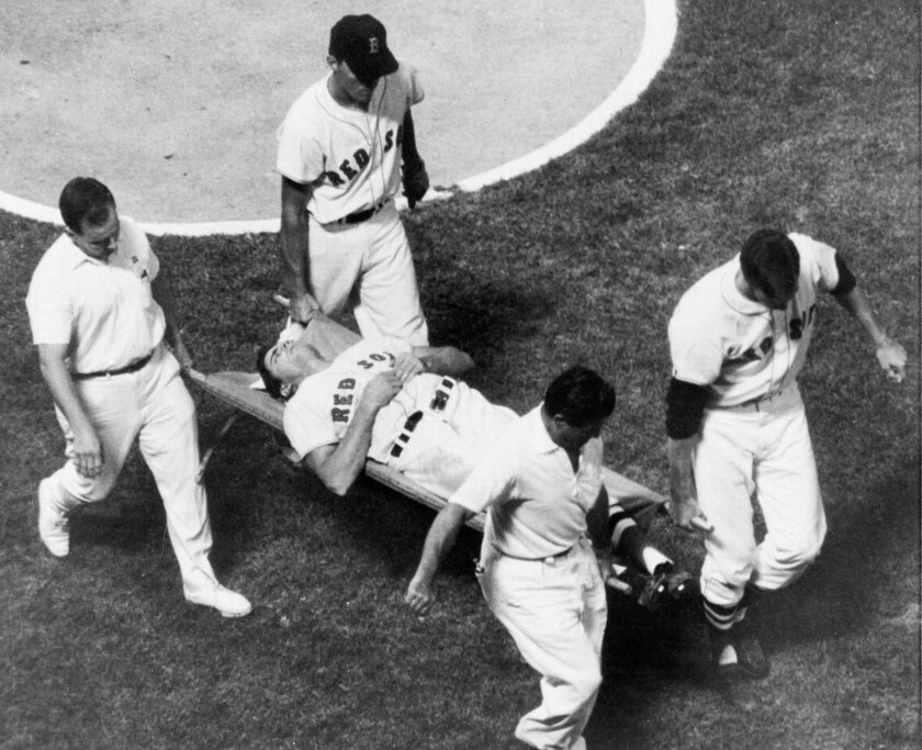 Boston Red Sox outfielder Tony Conigliaro is carried off the field on a stretcher by teammates and the trainers.