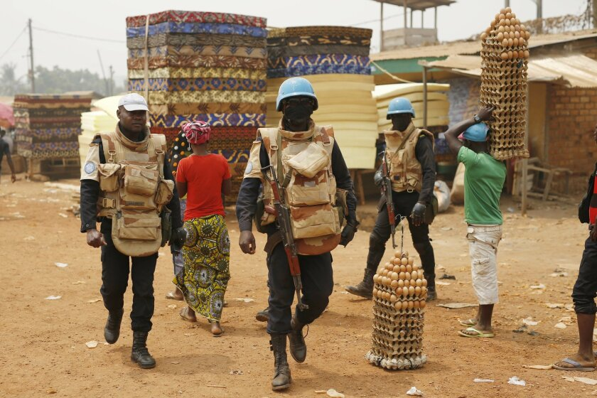 UN peacekeepers from Congo Brazaville walk in the PK5 district after  unloading a truck of its voting material and ballots at a polling station in Bangui, Central African Republic, Saturday Feb. 13, 2016. Two former prime ministers, Faustin Archange Touadera and   Anicet Georges Dologuele, are runn