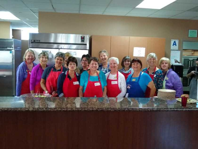 Members of the GFWC Contemporary Women of North County volunteered at Ronald McDonald House-San Diego and helped cook and serve a meal for families with children being treated for serious illnesses at local hospitals. From left, front row, Kathy Packard, Linda Breen, Rebecca Buchen, Kay Wilson, Cheryl Marians, Jean Smithers, Sandy Rabago, Gina Ensalaco. Back Row: Bonnie Woelfel (hidden), Pam Irwin, Joy Stefano, Sue Walsh, Kathy Shattuck. Visit cwonc.org.