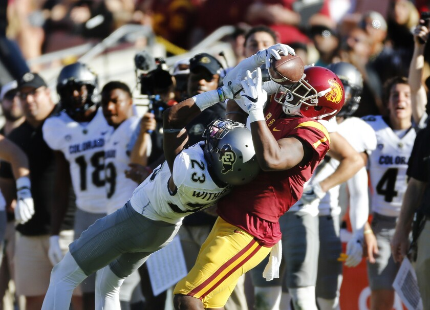 USC receiver Darreus Rogers (1) wrestles the ball away from Colorado's Ahkello Witherspoon, turning a potential interception into a 46-yard reception to set up the Trojans' go-ahead touchdown on Oct. 8.