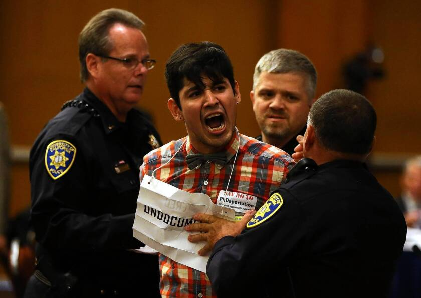 UC police arrest Alex Aldana during a protest of the confirmation of Janet Napolitano as head of the UC system.