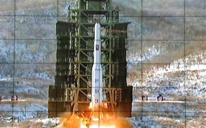 A screen at the General Satellite Control and Command Center shows the moment North Korea's Unha-3 rocket is launched in Pyongyang, North Korea, Wednesday, Dec. 12, 2012. North Korea successfully fired a long-range rocket on Wednesday, defying international warnings as the regime of Kim Jong Un took a big step forward in its quest to develop a nuclear missile. (AP Photo)