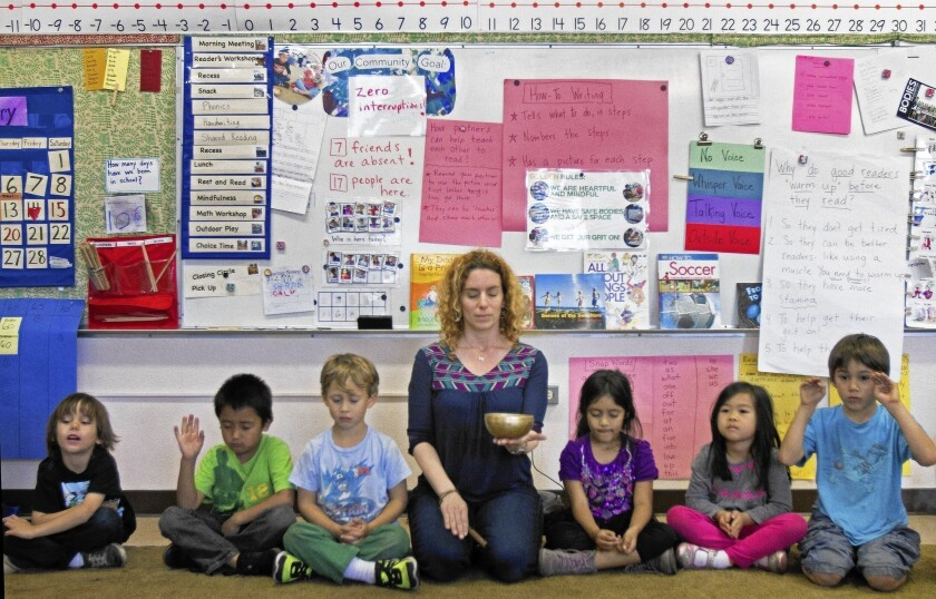 Sara Lev guides her kindergarteners through meditation at Citizens of the World, a charter school in Mar Vista.