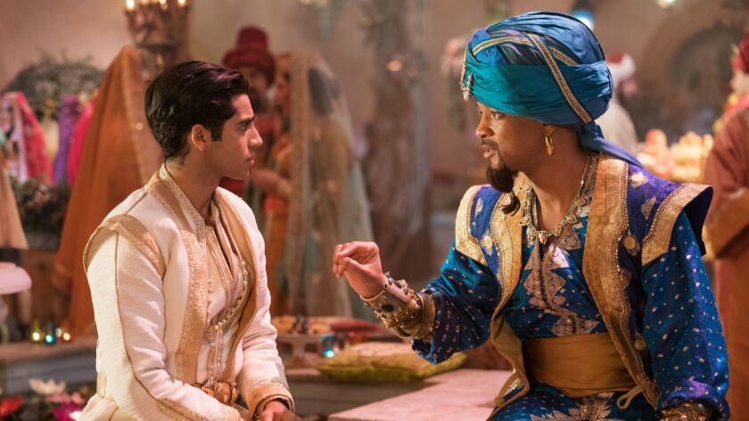 "Mena Massoud, left, and Will Smith in ""Aladdin."""
