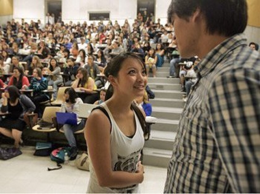 Angela Nguyen, 22, and Andy Nguyen, 21, UCSD students who are not related,  gazed into each other's eyes as part of a class exercise.    (Laura Embry / U-T)