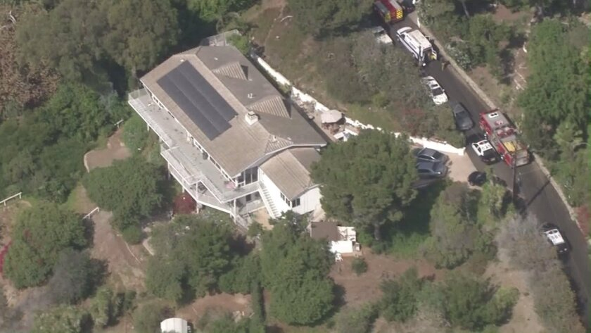 One man was shot and another man was stabbed at a home in Malibu on Friday.