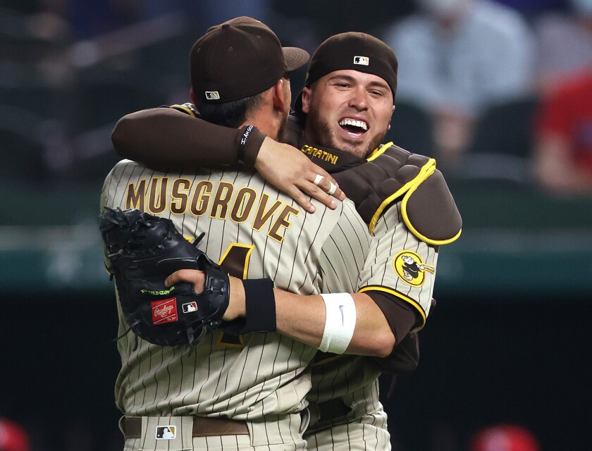 Joe Musgrove celebrates with Victor Caratini after pitching a no-hitter against the Texas Rangers.