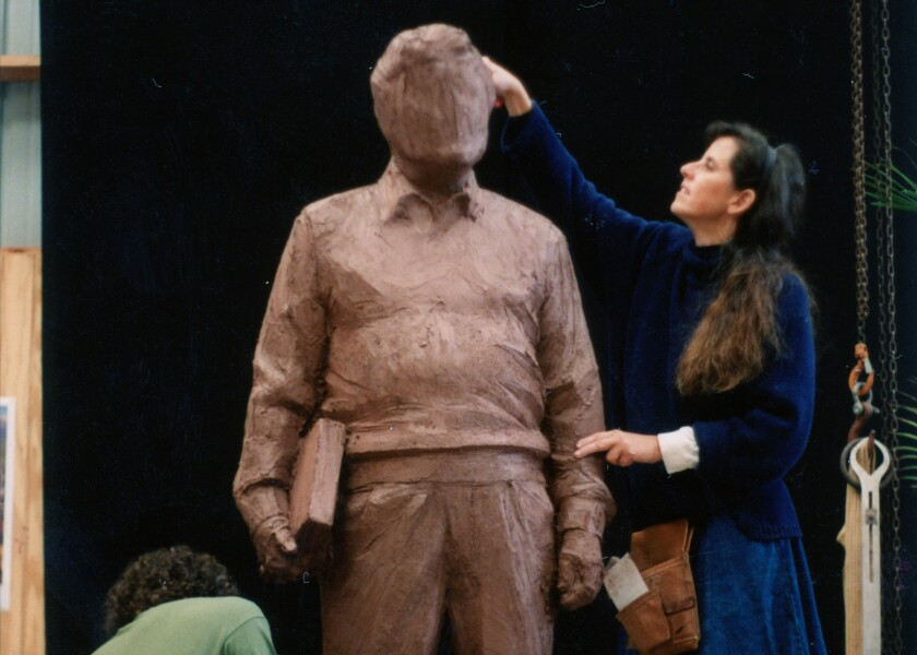 Sculptor T.J. Dixon works in the mid-1990s on the clay model for the bronze sculpture of César Chávez, which was installed on campus at Cal State San Marcos in March 1997.