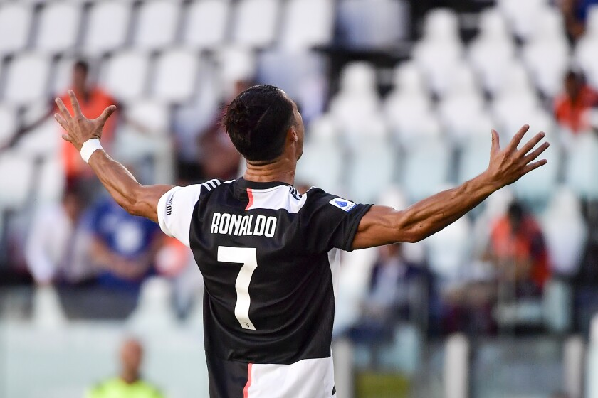 Juventus' Cristiano Ronaldo celebrates scoring his side's third goal, during the Serie A soccer match between Juventus and Torino, at the Allianz Stadium in Turin, Italy, Saturday, July 4, 2020. (Marco Alpozzi/LaPresse via AP)
