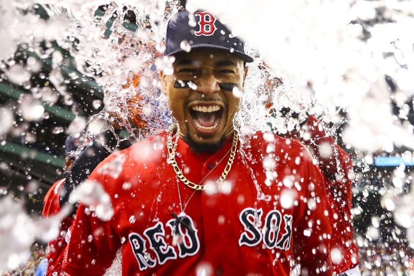 Boston Red Sox outfielder Mookie Betts gets an ice water shower following a win over the New York Yankees on July 26.